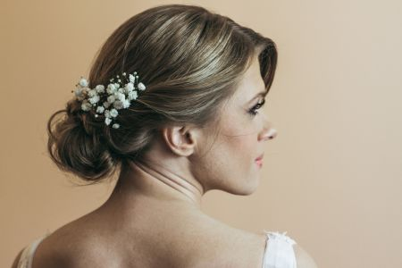 Romantic wedding low bun for Renata